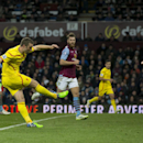 Liverpool's Rickie Lambert, left, scores during the English Premier League soccer match between Aston Villa and Liverpool at Villa Park Stadium, Birmingham, England, Saturday Jan. 17, 2015