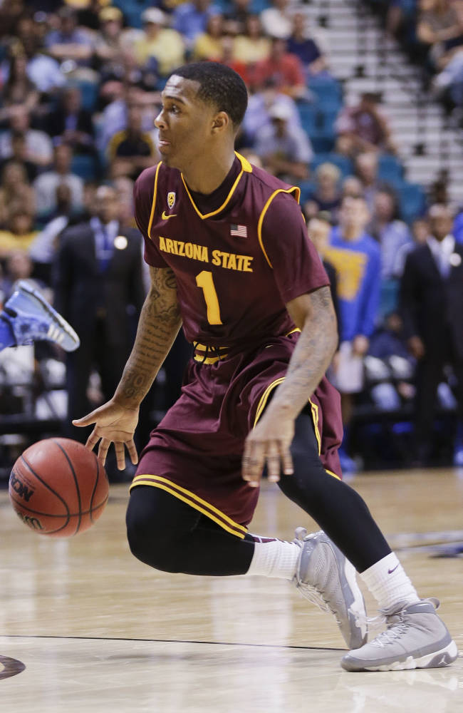 Arizona State's Jahii Carson drives to the lane against UCLA during a Pac-12 tournament NCAA college basketball game, Thursday, March 14, 2013, in Las Vegas