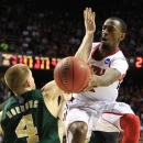 Louisville guard Russ Smith, right, passes the ball as Colorado State forward Pierce Hornung (4) defends during the first half of a third-round NCAA college basketball tournament game on Saturday, March 23, 2013, in Lexington, Ky. (AP Photo/James Crisp)
