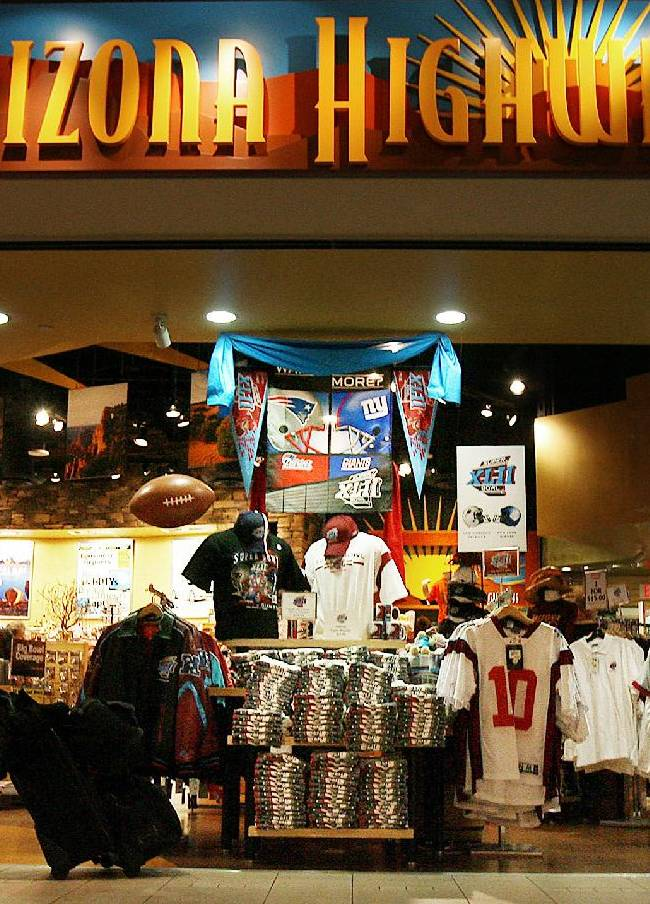 In this Jan. 29, 2008 file photo, Super Bowl merchandise is on full display in the Arizona Highways retail store at Phoenix Sky Harbor International Airport in Phoenix. Visitors spend money at NFL-funded events and buy NFL-branded memorabilia during Super Bowl week instead of frequenting local establishments, according to Philip Porter, an economics professor at the University of South Florida