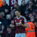West Ham's Stewart Downing celebrates after scoring his side's third goal during the English Premier League soccer match between West Ham and Hull City at Upton Park stadium in London, Sunday, Jan. 18, 2015