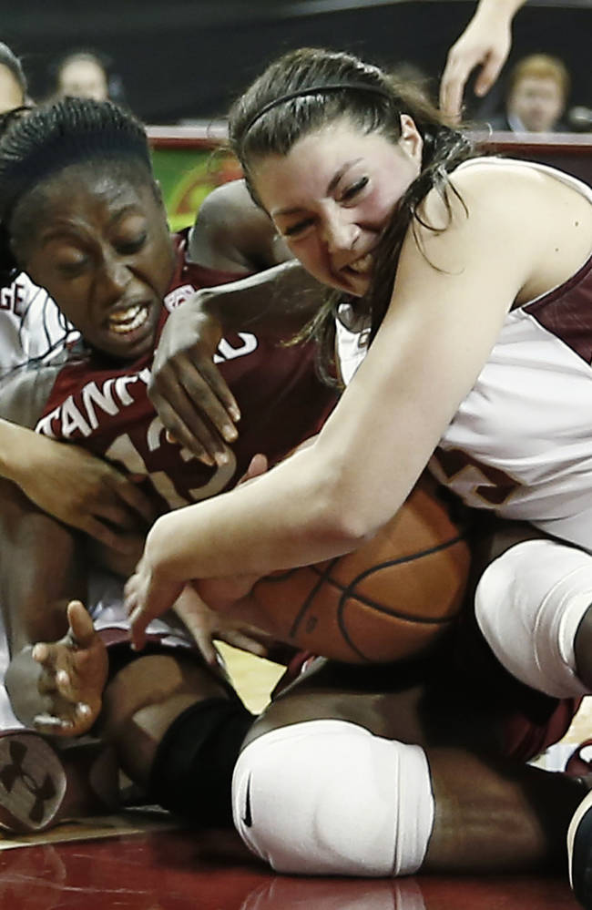 CORRECTS ID TO CHINEY OGWUMIKE, NOT ALEXA COULOMBE - Stanford's Chiney Ogwumike, center, and Boston College's Katie Zenevitch, right, and Shayra Brown battle for the ball during the first half of an NCAA college basketball game at Conte Forum in Boston Saturday, Nov. 9, 2013
