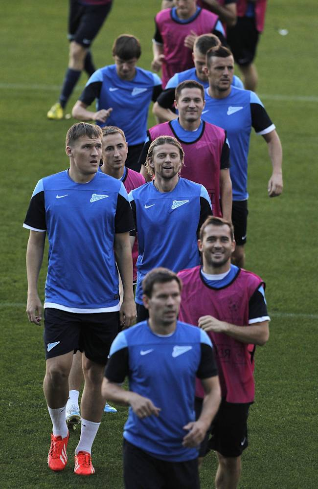 Zenit's players run during the last training session prior the Champions League Group G soccer match between Atletico de Madrid and Zenit in Madrid, Spain, Tuesday, Sept. 17, 2013