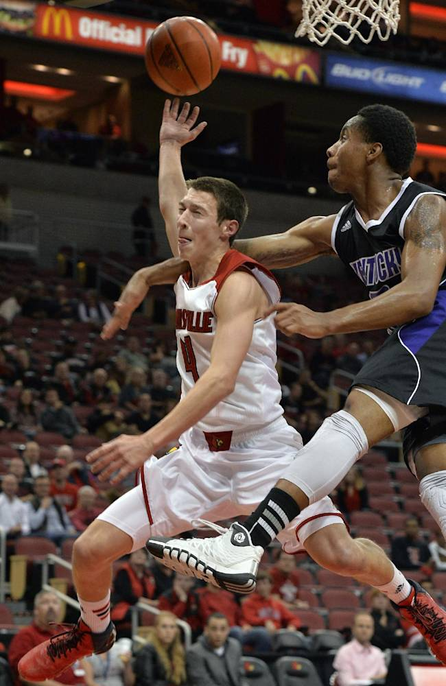 Louisville's Dillon Avare, left, is fouled by Kentucky Wesleyan's Ken-Jah Bosley during the second half of an exhibition NCAA college basketball game Tuesday, Oct. 29, 2013, in Louisville, Ky. Louisville defeated Kentucky Wesleyan 115-67