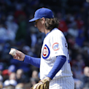 Chicago Cubs starter Jeff Samardzija checks the ball after Cincinnati Reds' Billy Hamilton hit an RBI double during the fifth inning of a baseball game in Chicago, Friday, April 18, 2014 The Associated Press