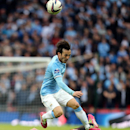 Sunderland's Phil Bardsley, on ground, vies for the ball with Manchester City's David Silva, top, during their English League Cup final soccer match at Wembley Stadium, London, England, Sunday, March 2, 2014