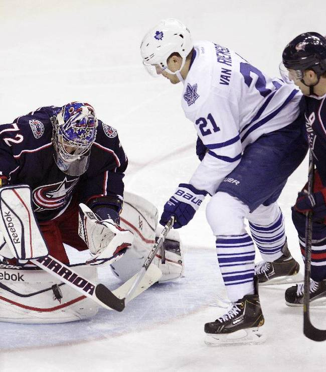 Columbus Blue Jackets' Sergei Bobrovsky, left, of Russia, makes a save as teammate Jack Johnson, right, and Toronto Maple Leafs' James van Riemsdyk wait for the rebound during the third period of an NHL hockey game on Friday, Oct. 25, 2013, in Columbus, Ohio. The Blue Jackets defeated the Maple Leafs 5-2
