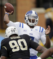 Duke quarterback Anthony Boone, looks to pass under pressure from Wake Forest defensive end Kristopher Redding (90) during the first half of an NCAA college football game in Winston-Salem, N.C., Saturday, Nov. 23, 2013. (AP Photo/Chuck Burton)
