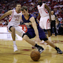 Phoenix Suns' Goran Dragic (1) drives past Houston Rockets' Francisco Garcia (32) during the first quarter of an NBA basketball game Wednesday, Dec. 4, 2013, in Houston The Associated Press