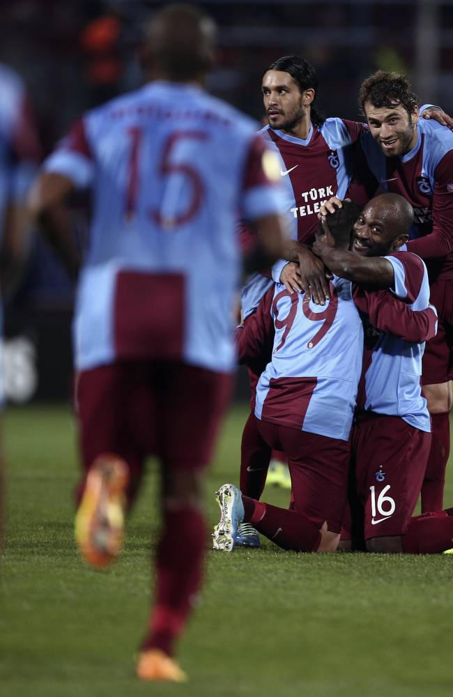 Trabzonspor soccer players, celebrate their 4-2 victory after their Europa League Group J soccer match with Apollon Limassol in Trabzon, Turkey, Thursday, Nov. 28, 2013. (AP Photo)