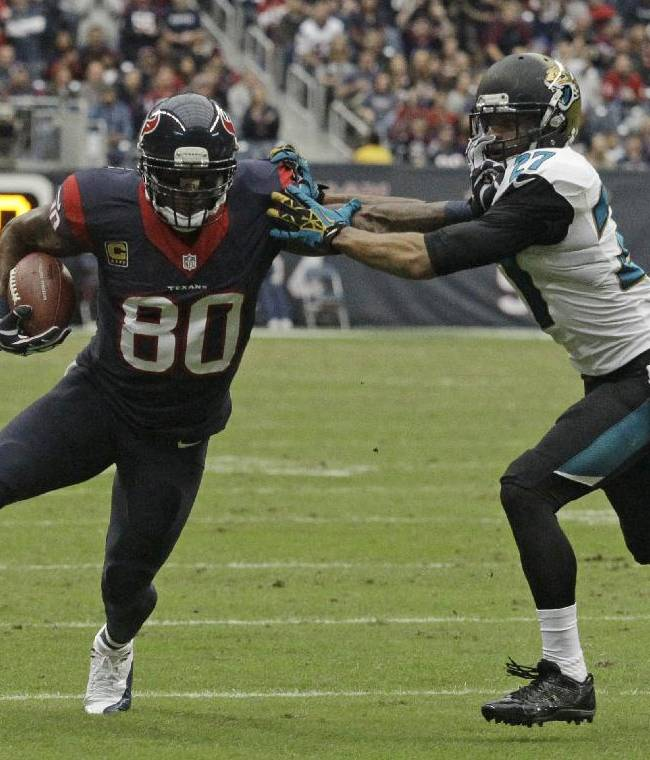 Houston Texans wide receiver Andre Johnson (80) is tackled by Jacksonville Jaguars cornerback Dwayne Gratz (27) during the third quarter of an NFL football game Sunday, Nov. 24, 2013, in Houston