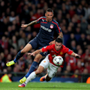 Manchester United's Robin van Persie, right, is fouled for a penalty by Olympiakos' Jose Holebas, left, during their Champions League last 16 second leg soccer match at Old Trafford Stadium, Manchester, England, Wednesday, March 19, 2014. (AP Photo/Jon Su