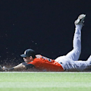 Miami Marlins left fielder Christian Yelich (21) can't reach a ball hit for a double by Atlanta Braves pinch hitter Jordan Schafer in the ninth inning of a baseball game Monday, April 21, 2014 in Atlanta. Atlanta won 4-2 in the tens innings The Associate
