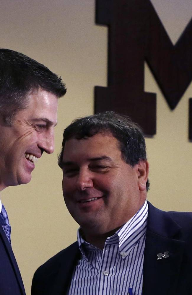 Doug Nussmeier, left, stands with head coach Brady Hoke after being introduced as Michigan's NCAAA college football offensive coordinator and quarterbacks coach during a news conference at the Junge Center in Ann Arbor, Mich., Friday, Jan. 10, 2014. Nussmeier is the former Alabama offensive coordinator