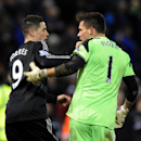 West Brom's goalkeeper Ben Foster right, reacts with Chelsea's Fernando Torres after the English Premier League soccer match between West Bromwich Albion and Chelsea at The Hawthorns Stadium in West Bromwich, England, Tuesday, Feb. 11, 2014