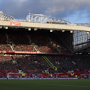 Old Trafford Stadium stands are bathed in sunshine during the English Premier League soccer match between Manchester United and Leicester at Old Trafford Stadium, Manchester, England, Saturday Jan. 31, 2015