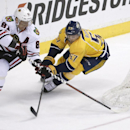Chicago Blackhawks right wing Marian Hossa (81), of Slovakia, sores as he is defended by Nashville Predators forward Gabriel Bourque (57) during the first period of an NHL hockey game Saturday, April 12, 2014, in Nashville, Tenn The Associated Press