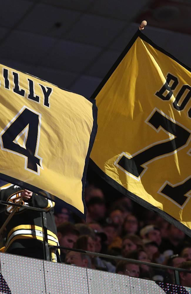 Fans wave banners before the start of Game 5 in the first round of the NHL hockey Stanley Cup playoffs between the Bruins and the Detroit Red Wings in Boston, Saturday, April 26, 2014. The Bruins lead the best-of-seven games series 3-1
