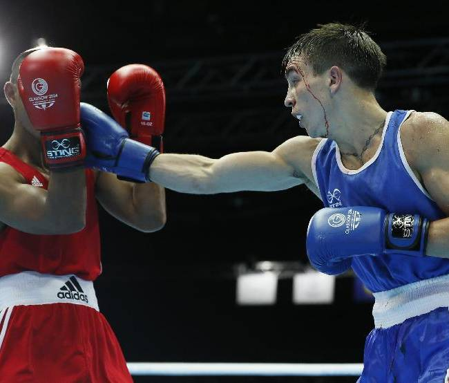 Michael Conlan of Northern Ireland, right, fights Matthew Martin from Nauru during their men's bantam weight (56kg) boxing bout at the Commonwealth Games Glasgow 2014, in Glasgow, Scotland, Friday, July, 25, 2014