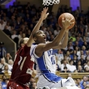 Duke's Rasheed Sulaimon (14) drives to the basket as Boston College's Ryan Anderson defends during the second half of an NCAA college basketball game in Durham, N.C., Sunday, Feb. 24, 2013. Duke won 89-68. (AP Photo/Gerry Broome)