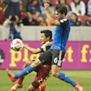 Real Salt Lake defender Tony Beltran (2) collides with San Jose Earthquakes midfielder Shea Salinas (6) during action between Real Salt Lake vs. San Jose Earthquakes, at Rio Tinto Stadium, Saturday, Oct. 11, 2014 The Associated Press