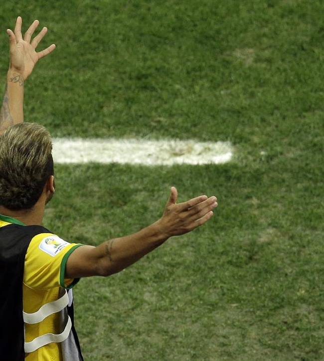 Brazil's Neymar gestures from the bench during the World Cup third-place soccer match between Brazil and the Netherlands at the Estadio Nacional in Brasilia, Brazil, Saturday, July 12, 2014