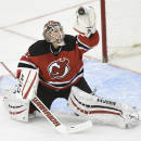 New Jersey Devils goaltender Cory Schneider gloves the puck during the second period of an NHL hockey game against the Anaheim Ducks Sunday, March 29, 2015, in Newark, N.J. (AP Photo/Bill Kostroun)