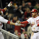 Washington Nationals' Adam LaRoche (25) and Jayson Werth (28) react after they both scored on a double by Anthony Rendon during the eighth inning of a baseball game against the Miami Marlins, Tuesday, April 8, 2014, in Washington. The Nationals won 5-0 Th