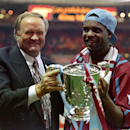 FILE - This is a March 27, 1994 file photo of Aston Villa manager Ron Atkinson holding the English League Cup with former Aston Villa player Dalian Atkinson at Wembley Stadium in London . English football club Sheffield Wednesday says Dalian Atkinson o