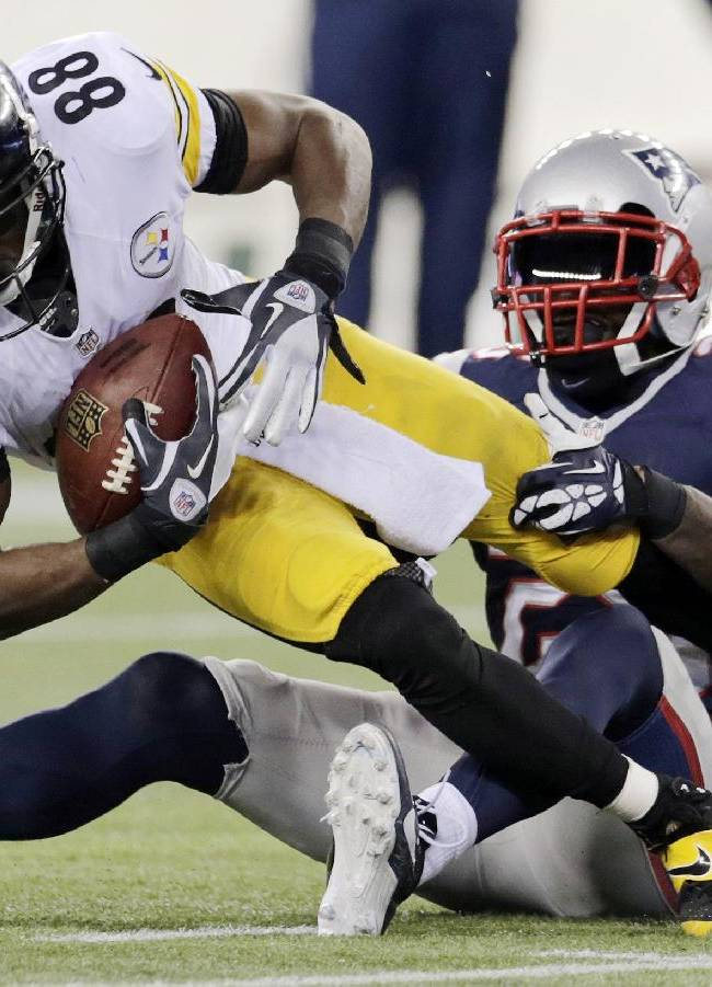 New England Patriots cornerback Kyle Arrington, right, tackles Pittsburgh Steelers wide receiver Emmanuel Sanders (88) in the fourth quarter of an NFL football game Sunday, Nov. 3, 2013, in Foxborough, Mass. The Patriots won 55-31
