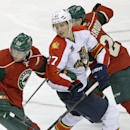 Florida Panthers' Nick Bjugstad, center, finds himself caught between Minnesota Wild's Ryan Suter, left, and Jonas Brodin in the third period of an NHL hockey game on Friday, Nov. 15, 2013, in St. Paul, Minn. The Wild won 3-2 The Associated Press
