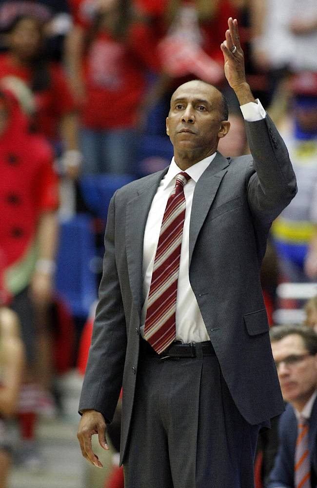 Stanford coach Johnny Dawkins tries to get his team's attention in the first half against Arizona in an NCAA college basketball game Sunday, March 2, 2014, in Tucson, Ariz. Arizona won 79-66