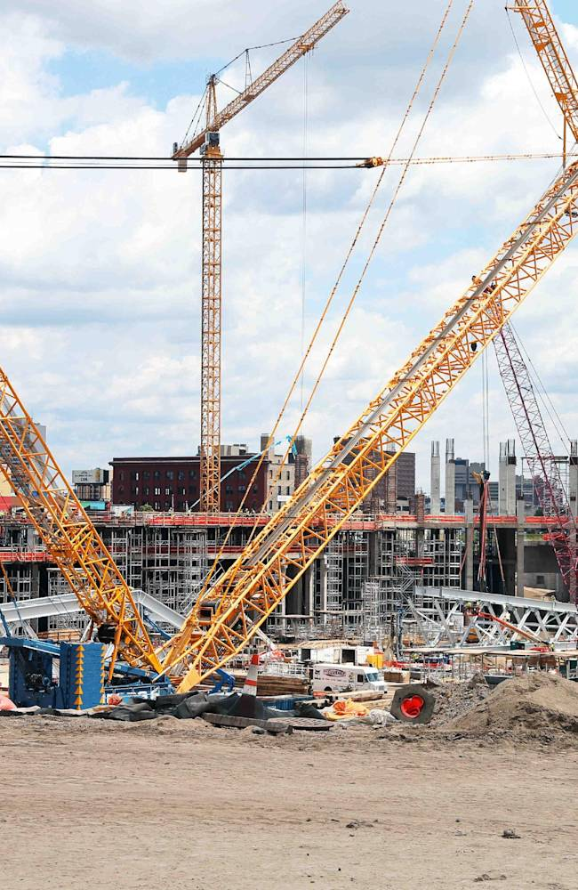 The v-shape of one of the largest cranes in the world stands on the Minnesota Vikings new NFL football stadium Wednesday, July 9, 2014, In Minneapolis where testing started. When fully erect, it will stand almost 400 feet high