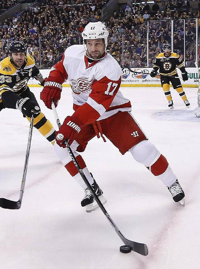 Detroit Red Wings' David Legwand (17) and Boston Bruins' Zdeno Chara (33) battle for the puck during the first period in Game 5 in the first round of the NHL hockey Stanley Cup playoffs  in Boston, Saturday, April 26, 2014