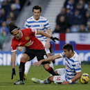 Queens Park Rangers' Esteban Granero, right, and Joey Barton, center back, compete for the ball with Manchester United's Radamel Falcao, left, during the English Premier League soccer match between QPR and Manchester United at Loftus Road stadium in Londo