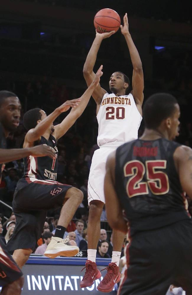 Minnesota's Austin Hollins (20) shoots over Florida State's Devon Bookert (1) during the first half of an NCAA college basketball game in the semifinals of the NIT on Tuesday, April 1, 2014, in New York. Minnesota won 67-64
