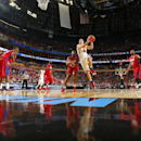 Ohio State's Aaron Craft (4) drives past Dayton's Kendall Pollard (22) during the second half of a second-round game in the NCAA college basketball tournament in Buffalo, N.Y., Thursday, March 20, 2014. Dayton won the game 60-59 The Associated Press