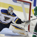 St. Louis Blues goalie Brian Elliott (1) defends the goal against Dallas Stars center Vernon Fiddler (38) during the second period of an NHL pre-season hockey game, Monday, Sept. 22, 2014, in Dallas The Associated Press