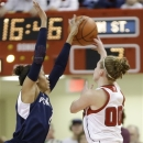 Penn State's Dara Taylor, left, knocks the ball away from Nebraska's Lindsey Moore (00) in the first half of an NCAA college basketball game in Lincoln, Neb., Sunday, March 3, 2013. (AP Photo/Nati Harnik)