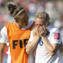 England's Josanne Potter, left, consoles Laura Bassett (6) after the team's 2-1 loss to Japan during a semifinal in the FIFA Women's World Cup soccer tournament, Wednesday, July 1, 2015, in Edmonton, Alberta, Canada. Japan won 2-1. (Jason Franson/The Canadian Press via AP)