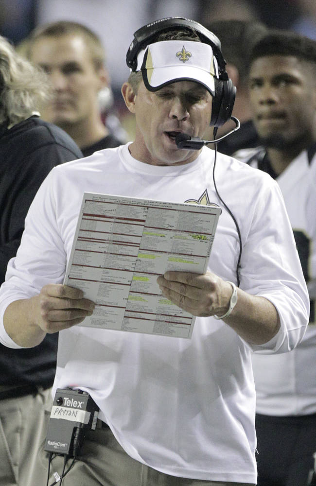 New Orleans Saints head coach Sean Payton looks at plays against the Atlanta Falcons during the first half of an NFL football game, Thursday, Nov. 21, 2013, in Atlanta