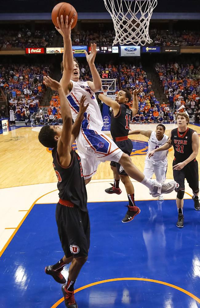 Boise State's Anthony Drmic (3) shoots over Utah's Kenneth Ogbe (25) during the second half of an NCAA college basketball game in Boise, Idaho, on Tuesday, Dec. 3, 2013. Boise State beat Utah 69-67