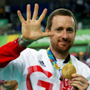 FILE PHOTO: 2016 Rio Olympics - Cycling Track - Victory Ceremony - Men's Team Pursuit Victory Ceremony - Rio Olympic Velodrome - Rio de Janeiro, Brazil - 12/08/2016. Bradley Wiggins (GBR) of Britain poses with his gold medal. REUTERSEric Gaillard/File Photo.