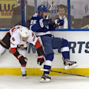 Tampa Bay Lightning's Matthew Carle (25) collides with Ottawa Senators's Chris Neil, left, on the boards during the second period of an NHL hockey game Saturday, Oct. 11, 2014 in Tampa, Fla The Associated Press