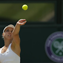 Sabine Lisicki of Germany throws the ball up as she serves to Simona Halep of Romania during their women's singles quarterfinal match at the All England Lawn Tennis Championships in Wimbledon, London, Wednesday, July 2, 2014. (AP Photo/Pavel Golovkin)