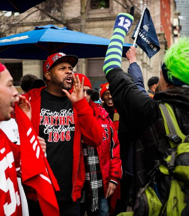 San Francisco 49ers fans playfully heckle a Seattle Seahawks fan during a rally outside of the J and M Cafe a day before the NFC championship face-off between the NFL football teams Saturday, Jan. 18, 2014, in Pioneer Square in Seattle, Wash. Police later showed up on the scene to keep the peace between rival fans