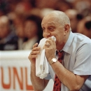 FILE - In this April 2, 1990, file phot, UNLV coach Jerry Tarkanian chews on his towel while watching his Runnin' Rebels run over Duke University in the championship game of the Final Four in Denver. Tarkanian was in his element last weekend, watching UNLV from a courtside seat in the venue he helped build. As the NCAA tournament continues, the only question left about Tarkanian's legacy is why he's not in the Hall of Fame. (AP Photo/Ed Reinke, File)