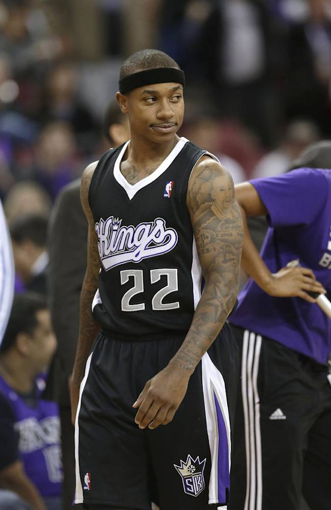 Sacramento Kings guard Isaiah Thomas grimaces as he walks down court during the closing moments of the Kings' 104-98 overtime loss to the Los Angeles Clippers in an NBA basketball game in Sacramento, Calif., Friday, Nov. 29, 2013