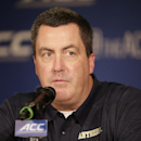 FILE - In this July 21, 2014, file photo, Pittsburgh head coach Paul Chryst answers a question during a news conference at the Atlantic Coast Conference Football kickoff in Greensboro, N.C. The University of Wisconsin plans a news conference, Wednesday, Dec. 17, 2014, to update their search for a new football coach to replace Gary Andersen. Pittsburgh's Paul Chryst has been widely reported to be the university's choice. (AP Photo/Chuck Burton, File)