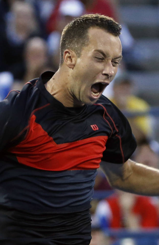 Philipp Kohlschreiber, of Germany, celebrates his upset victory over John Isner, of the United States, at the U.S. Open tennis tournament, Saturday, Aug. 30, 2014, in New York. Kohlschreiber won 7-6 (4), 4-6, 7-6 (2), 7-6 (4)